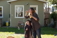 Mom, Julie blowing bubbles with autistic daughter