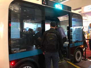 Accessible Olli bus with man getting on