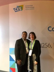 man and woman in front of CES signage