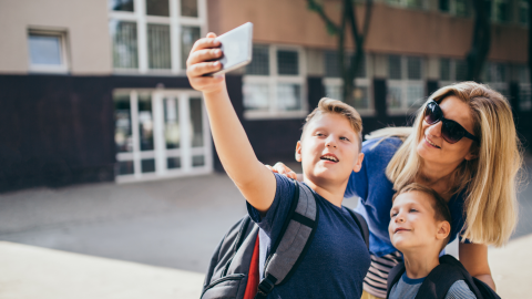 mom and 2 boys taking selfie