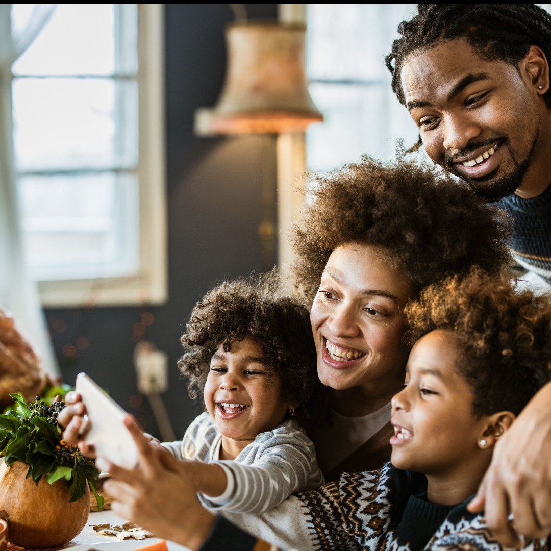 smiling family using iPad