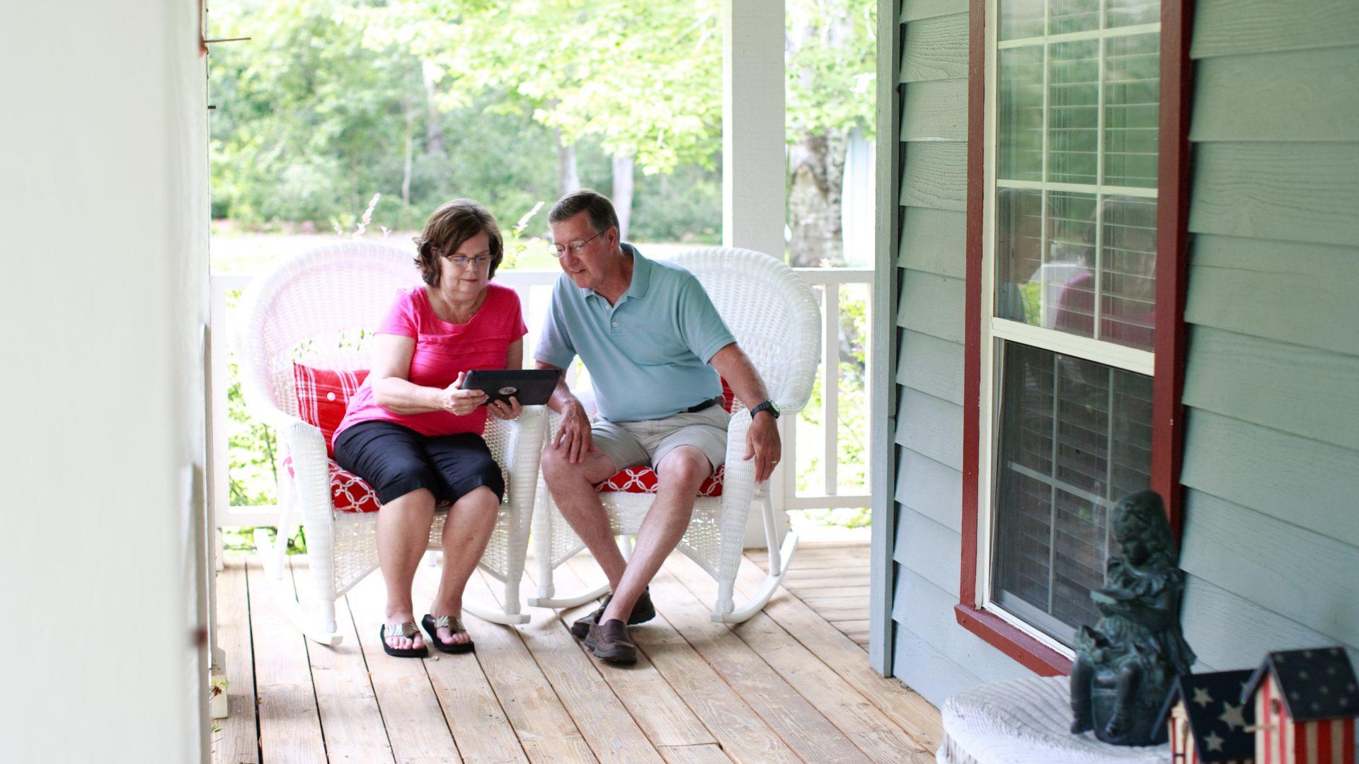older adult couple using ipad